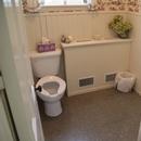 Salle de toilette mixte partiellement accessible