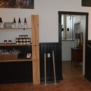 Porte d'accès à la microbrasserie (via escaliers) et aux toilettes, depuis la boutique