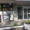 Portes d'entrée (directement à la pharmacie à gauche - par la résidence à droite)